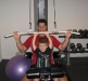 Kyle shows Daddy how to do the lat pulldown.