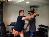 Eric helps client Ed with rope tricep extension.
