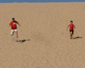 Running down Sleeping Bear Dunes with Kyle