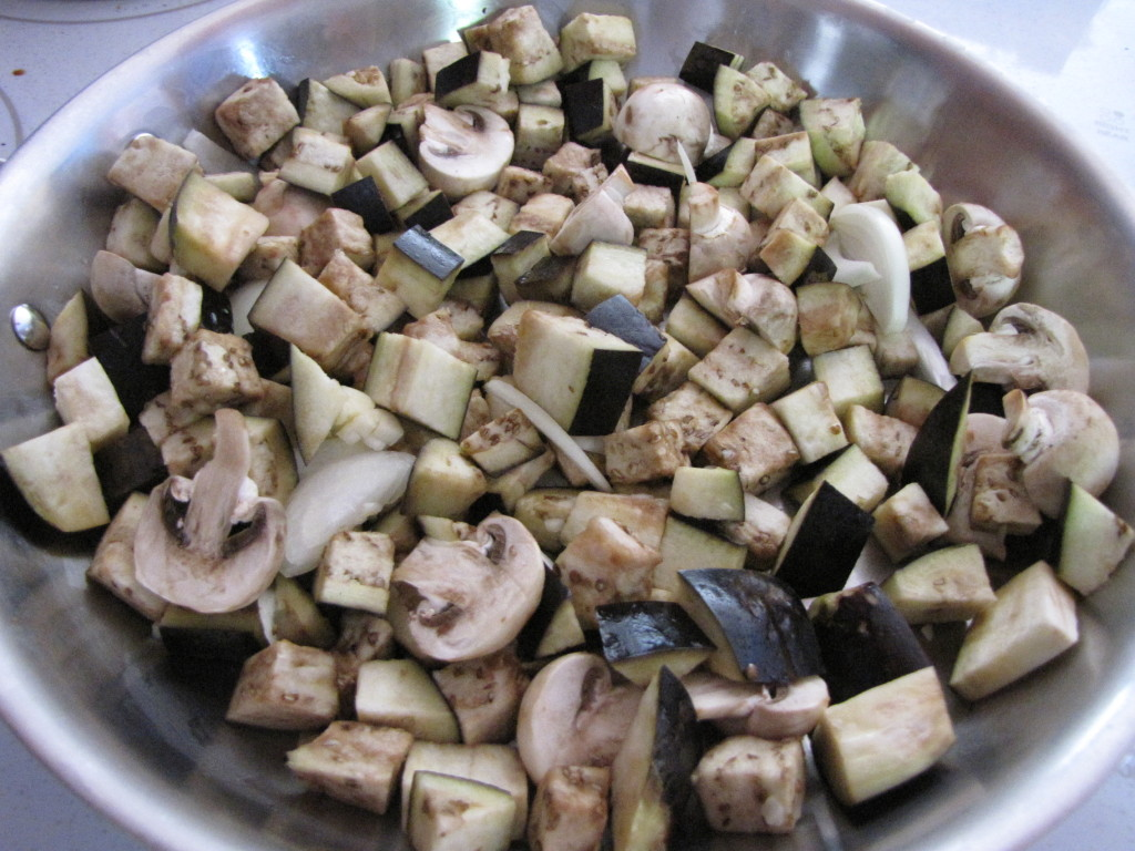 Eggplant, mushrooms and onions in the skillet